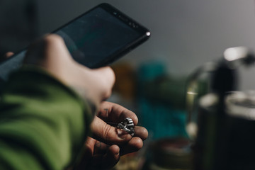 Jeweler taking picture of a ring