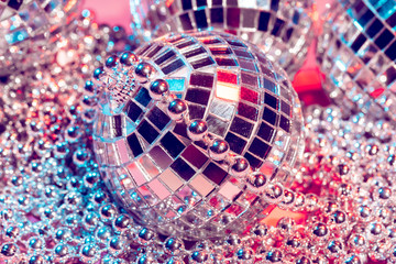 disco balls for decorationof a party on  pink  background