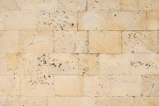 Texture of old limestone brick wall
