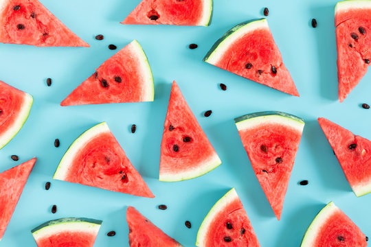 Sliced watermelon on light blue background. Watermelon slice. Summer concept. Flat lay, top view, copy space