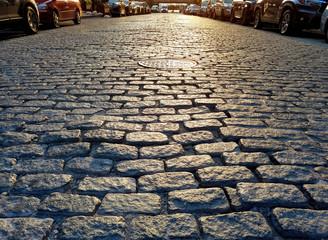Sunlight shines on the cobblestones of Harrison Street in the Tribeca neighborhood of Manhattan in New York City