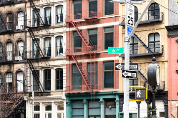 Block of colorful old apartment buildings on 6th Avenue in the Tribeca neighborhood of New York City