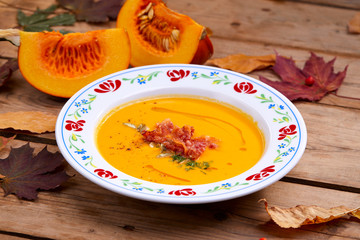 pumpkin cream soup on the wooden background