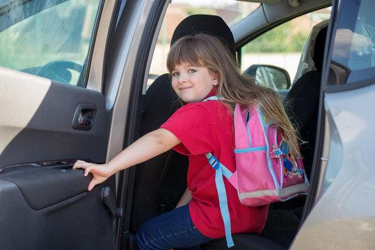 Back to school .Cute cheerful schoolgirl going school