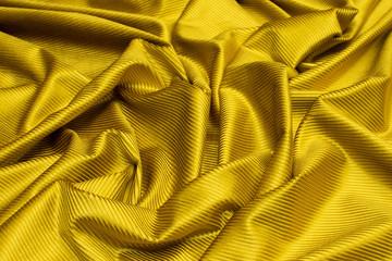 Yellow viscose fabric texture. Velveteen. Background, pattern.