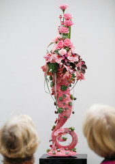 Visitors view a floral design at the Floral Art and Design Show in London