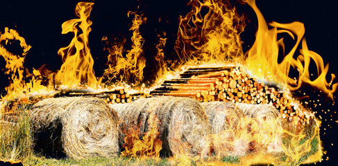 Conflagration over beaten wood and hay bales