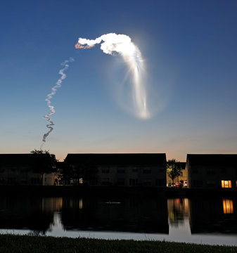The contrail of a United Launch Alliance Atlas 5 rocket is illuminated by the sun after liftoff as viewed from central Florida
