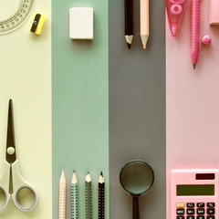 Stationary items on pastel color paper background, back to school flat lay concept