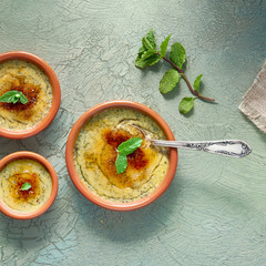 Creme brulee, or Crema Catalana, the Spanish variation of this traditional custard dessert, made in traditional cazuela dishes