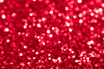 Red glitter festive background with bokeh lights. Celebration concept for Holidays and anniversary.