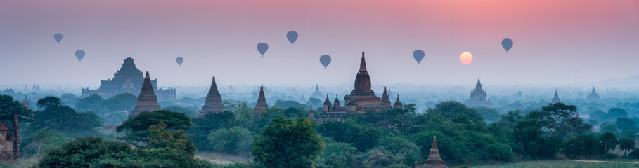 Morning Glory Bagan panorama with temples and hot air-ballons during sunrise