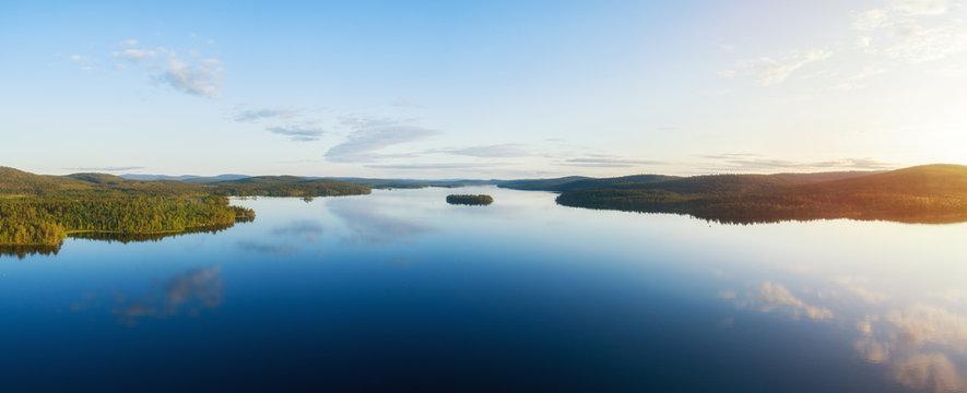 Aerial panorama of beautiful lake Inari, islands and green forest at sunset. Inarijarvi,Lapland