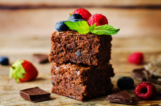 Chocolate brownie with berries and mint leaves