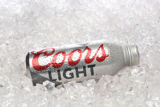 IRVINE, CALIFORNIA - APRIL 15, 22019: A Coors Light Aluminum Pint Bottle laying in a bed of ice.