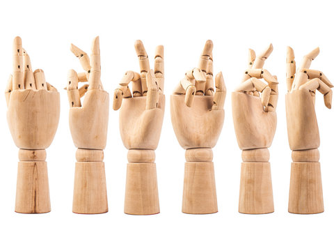 hand of wood doll make fingers to touch on white bakground