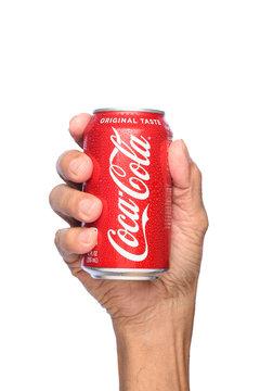 IRVINE, CALIFORNIA - APRIL 26, 2019: Closeup of a hand holding a cold can of  Coca-Cola.