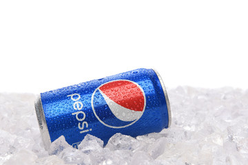 IRVINE, CALIFORNIA - JUNE 28, 2019: A 7.5 ounce cans of Pepsi Cola in ice with white background.