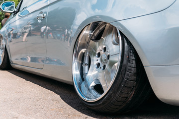 Lowrider custom tuned sport car wheel with small rubber tyre and large disk