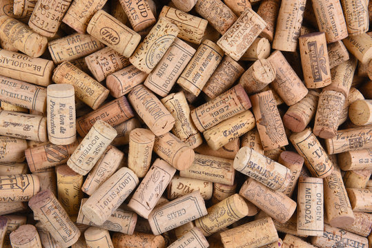 IRVINE, CALIFORNIA - FEBRUARY 14, 2018: A pile of imported wine corks from a variety of wineries and countries.