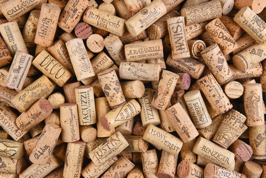 IRIVNE, CALIFORNIA - FEBRUARY 14, 2018: A pile of Predominently California wine corks with a variety of logos and names.