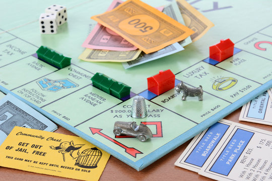 IRVINE, CA - May 19, 2014: Monopoly Board Game Closeup. The classic real estate trading game from Parker Brothers was first introduced to America in 1935.