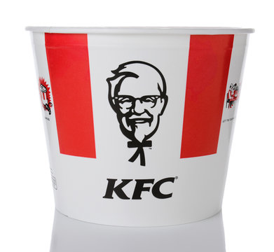IRVINE, CA - JANUARY 15, 2015: A Bucket of KFC Chicken. Initially Kentucky Fried Chicken, founded by Harland Sanders, the fast food restaurant chain is now owned by Yum! Brands.
