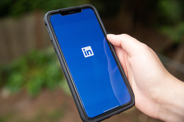 General view of LinkedIn app opening on iPhone XS Max in Everett, Washington on August 8, 2019