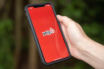 General view of the Yelp app opening on iPhone XS Max in Everett, Washington on August 8, 2019