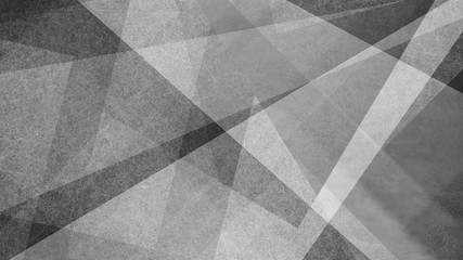 Abstract black and white background with geometric striped and triangle patterns. Elegant textured stripes shapes and angles in modern contemporary design.