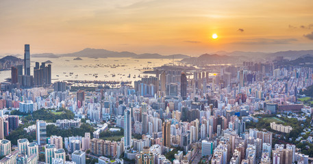 Sunset of Victoria Harbor, cityscape of Hong Kong