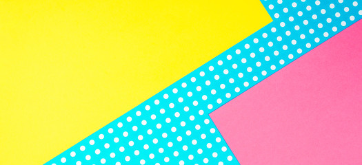 Texture background of fashion papers in memphis geometry style. Yellow, blue, pink colors