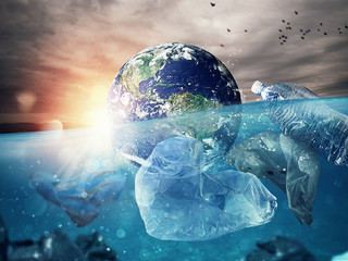 The Earth floats in the sea full of plastic. Save the World. World provided by NASA.