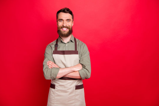 Portrait of his he nice attractive cheerful cheery content bearded guy restaurant fast food owner folded arms isolated over bright vivid shine red background