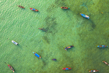 aerial top view fishing boats parking on the beach during low tide at Rawai beach Phuket Thailand top view fishing boats in the shore during low tide at Rawai beach Phuket Thailand