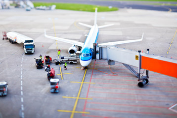 Düsseldorf, Germany - June 2011: Tilt-Shift image of airplane being serviced at DUS airport