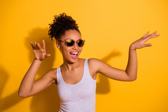Close up photo beautiful nice pretty she her dark skin lady summer weekend rest relax dancing festive vacation fest modern moves motion wear sun specs casual tank-top isolated bright yellow background