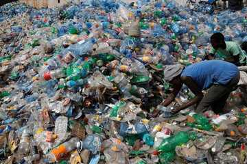 Employees sort plastic bottles at the Weeco plastic recycling factory at the Athi River industrial zone near Nairobi