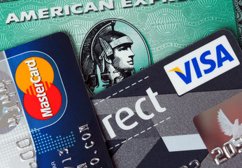 Ratingen, Germany - June 21, 2011: Closeup studio shot of  credit cards issued by the three major brands American Express, VISA and MasterCard.