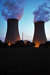 nuclear power plant on a black background of blue sky