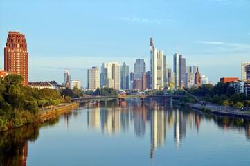 Foto op Aluminium Kuala Lumpur Frankfurt's Skyline reflecting in the Main River on sunrise. european city skyline and financial centre of Frankfurt. Germany Skyscraper buildings on blue sky background. Business and finance concept