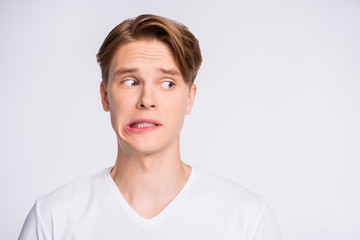 Close-up portrait of his he nice cute attractive worried uncertain guy looking aside oops mistake fail isolated over light white pastel background Fototapete