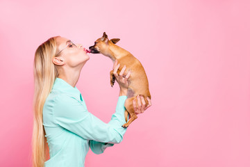 Profile side photo of lovely person having eyeglasses eyewear hold doggy liking her wearing mint color shirt isolated over pink background