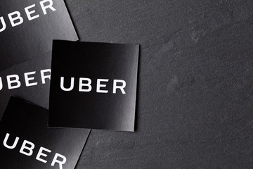 A photograph of  the Uber logo. Uber is a popular taxi style transport service application, founded in 2009