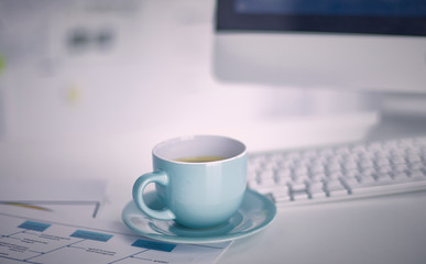 A cup of coffee on the office table