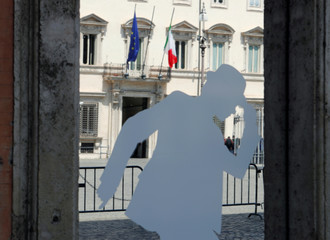 The entrance of the Chigi Palace is seen reflected on a shop window, following the news that League's leader and Deputy Prime Minister Matteo Salvini declared the governing coalition to be unworkable and called for new elections, in Rome