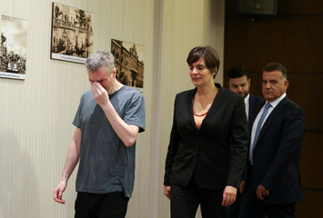 Canadian citizen, Kristian Lee Baxter, who was being held in Syria reacts as he walks next to Canadian Ambassador to Lebanon, Emmanuelle Lamoureux and Major General Abbas Ibrahim, Lebanon's internal security chief, after being released, in Beirut