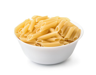 Bowl of uncooked penne lisce pasta