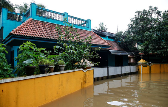 A view shows exteriors of a partially submerged residential house on the outskirts of Kochi