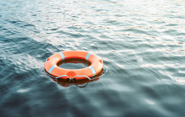 Fototapeta Life buoy floating on the water with copy space obraz